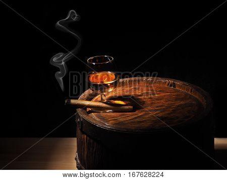 Cognac And Cigar On Old Oak Barrel