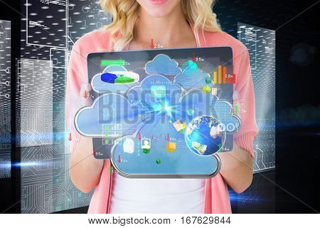 Young pretty student showing tablet pc against hologram on futuristic background