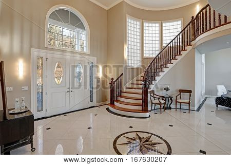 Stunning two story entry foyer with lots of space boasts marble mosaic tile floor front door framed with arch window sidelights and grand staircase with glossy wood curved banister. Northwest USA poster