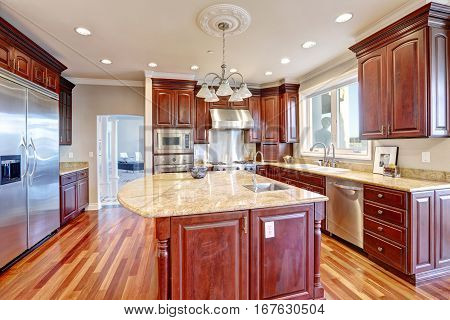 Welcoming Kitchen With Large Kitchen Island