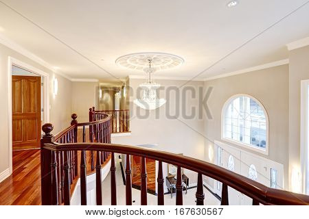 Panoramic View Of Spacious Foyer From Staircase Landing