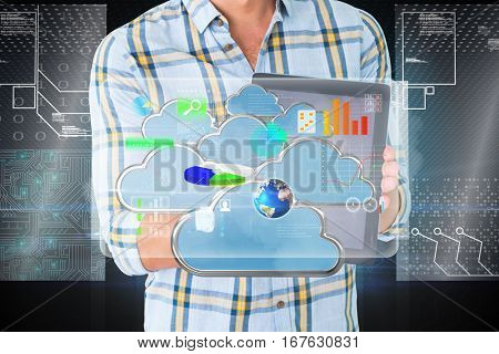Young student showing tablet pc against hologram on futuristic background