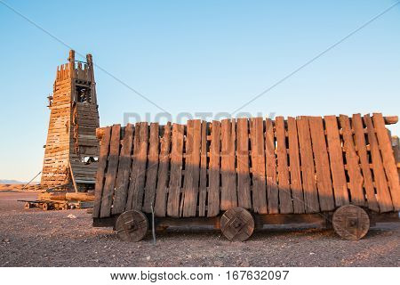 Battering ram and siege tower in a desert