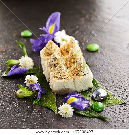 Maki Sushi - Sushi Roll Rice outside. Japanese Sushi Food and Natural Flower Concept