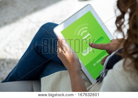 Loading screen against woman pointing at digital tablet outdoors