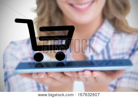 Pretty hipster showing tablet against white background with vignette