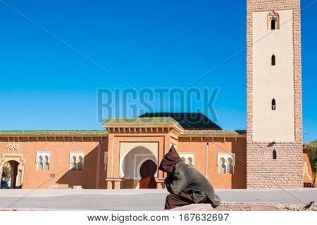 Single homeless man outside the mosque of Ouarzazate