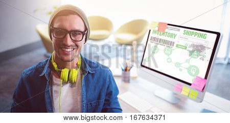 Image inventory shipping against man smiling while sitting on chair by computer