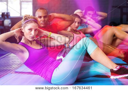 Portrait of friends with hands behind back while stretching in gym