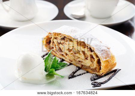 Apple strudel with vanilla ice cream on a plate