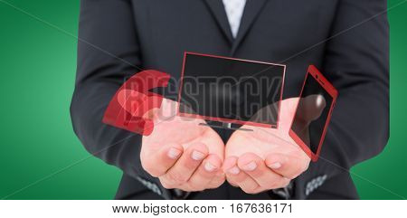 Businessman holding his hands out against green vignette 3d