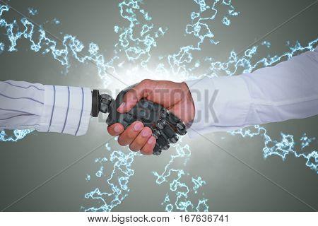 Composite image of businessman and robot shaking hands against green vignette