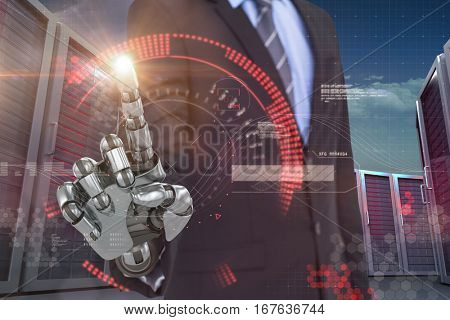Graphic image of businessman with robotic hand against digital generated image of red dial 3d