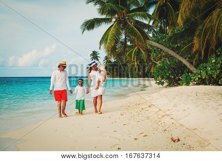happy family with kids walking on tropical sand beach