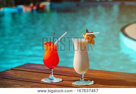 Two cocktails on tropical beach resort, romantic vacation