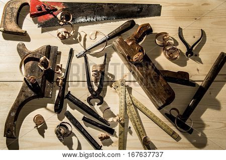 Old Woodworks Tools: Wooden Planer, Hammer, Chisel In A Carpentry Workshop On Wood Background