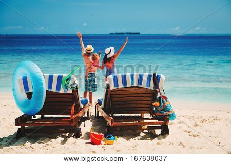 happy family with small child on tropical beach, family beach vacation