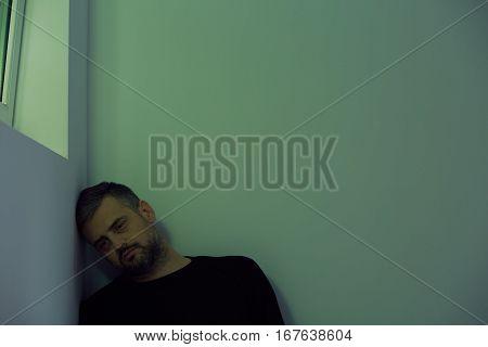 Broken Man In Room Corner