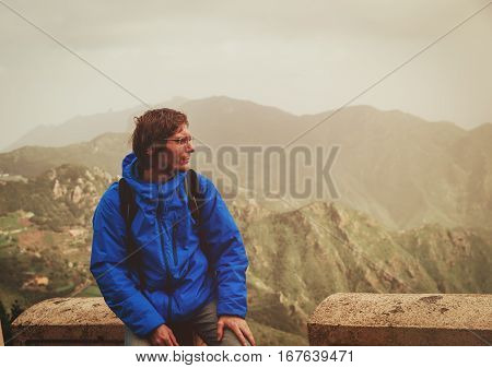young tourist looking at mountains while travel