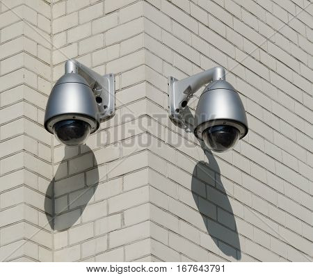 CCTV Security Cameras. Security cameras mounted on the outdoors brick wall