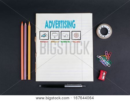 Advertising concept. Line notebook on a black office desk.