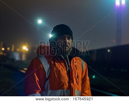 Portrait of young construction worker at night