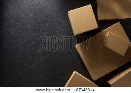cardboard box d on  black background