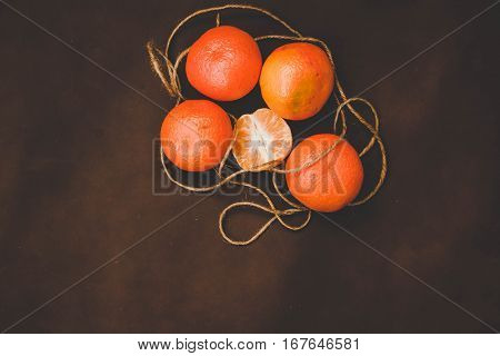 Mandarins on Brown background. Food sweet fruit