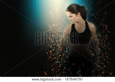 Young Woman Fight Posing Glow Particles Effect