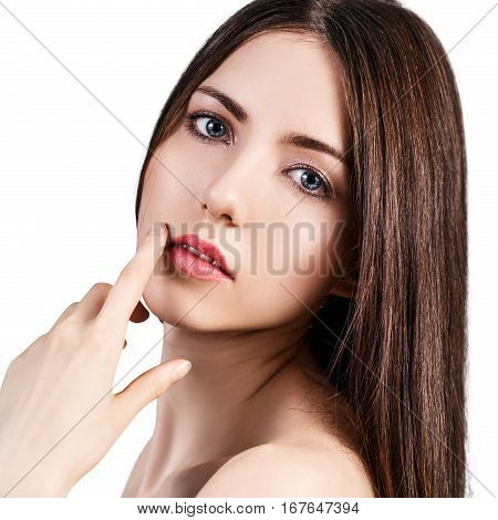 Young beautiful woman with healty fresh skin over white background. Spa concept.