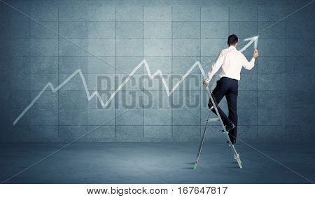 A man standing on a ladder and drawing a chart on blue wall background with exponential progressing curve, line