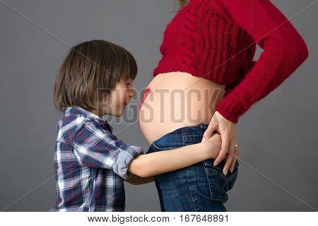 Beautiful Preschool Child, Hugging His Pregnant Mom