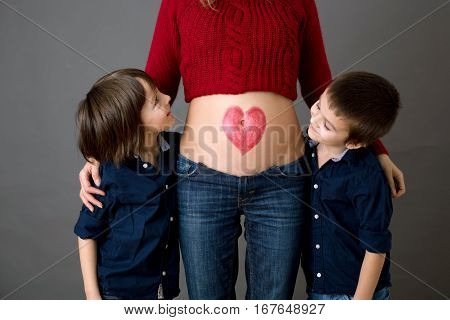 Beautiful Preschool Children, Hugging Their Pregnant Mom