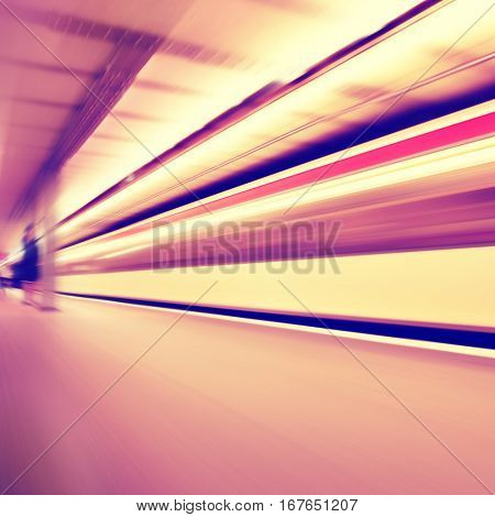 Train in motion blur at subway station. Vintage color.