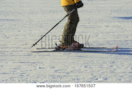 part of skiers on a snow