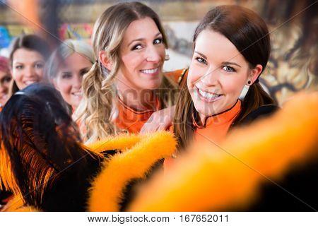 Young women as germen red Funken folklore dance group in fasching carnival
