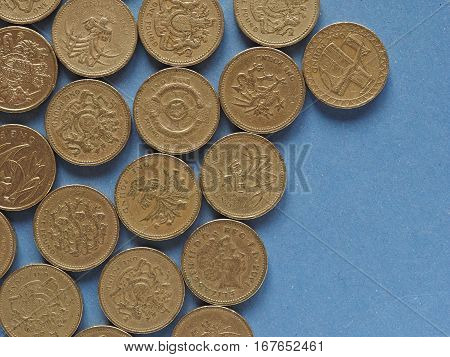 Pound Coins, United Kingdom Over Blue With Copy Space