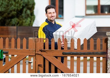 Postman delivering packet wrapped as present