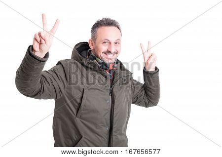 Male Posing Wearing Winter Jacket Showing Peace Gesture