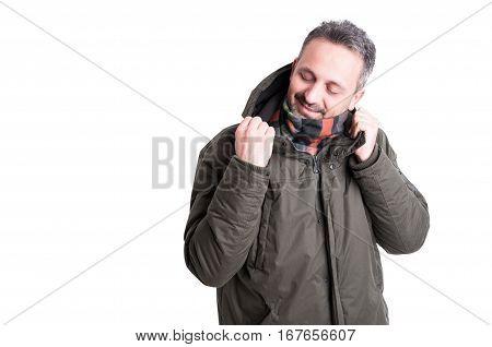 Man Posing Looking At His Winter Jacket