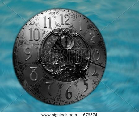 Grandfather Clock Face Floating In Water