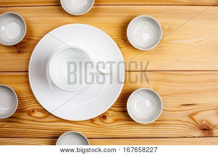 Empty Ceramic Dishware On A Wooden Table, Top View, Copy Space
