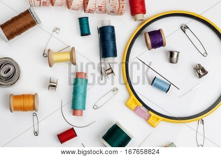 Spools Of Thread, Needles And Other Sewing Stuff On A White Background, Flat Lay Composition, Close-
