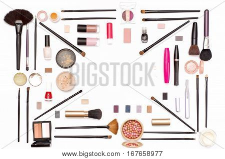 cosmetic makeup: eye shadow brushes mascara powder and other accessories for women on white background top view. beauty flat lay concept.