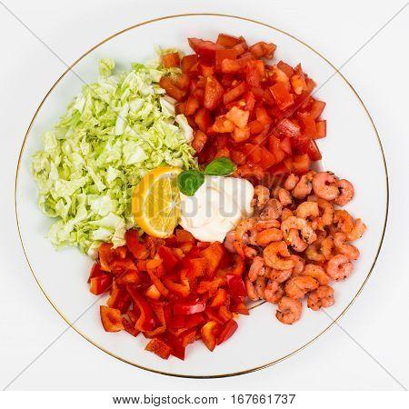 Vegetable salad with shrimp and oregano on a white background. Studio Photo