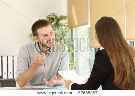 Confident man talking to his interviewer during a job interview