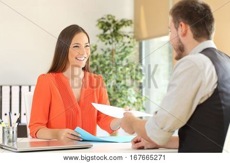 Woman giving a resume to the interviewer in a job interview