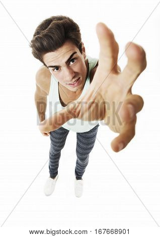 Man from above trying taking something with one hands on white. A young man seen from above stretches out his arm to catch and grab something with one hands. In studio on white background.