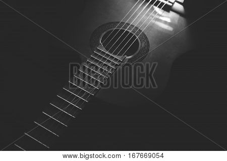Acoustic Guitar on  white and black background