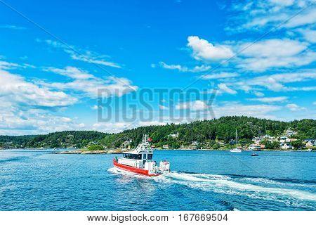 Boat on Norwegian fjord. Good water landscape poster